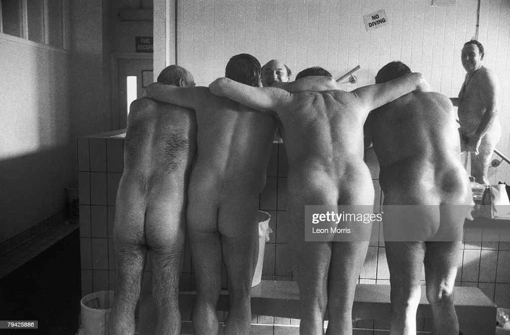 A group of coal miners in the bath-house after a shift, circa 1985.
