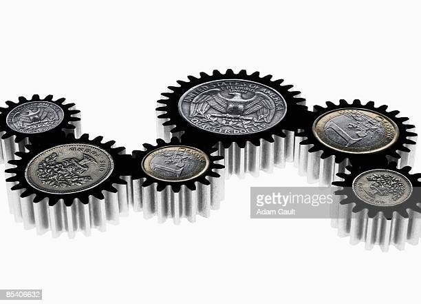Group of cogs with coin symbols