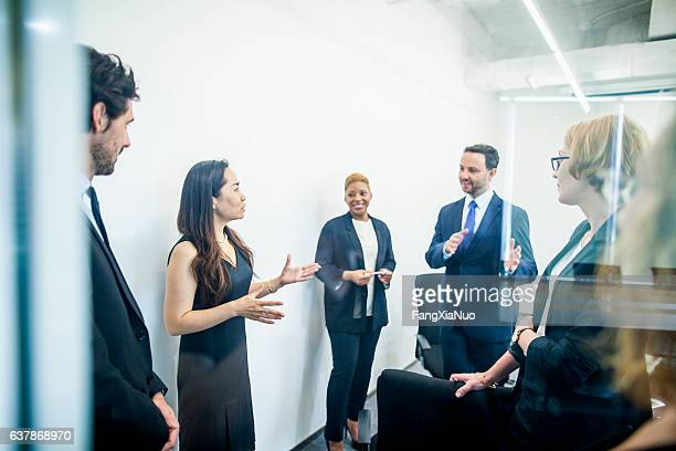 Group of colleagues having business meeting in office