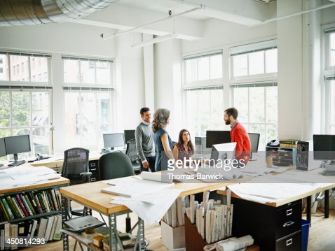 Group of colleagues in informal meeting in office : Stock Photo