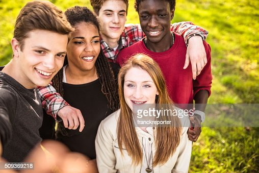 Group of college student laughing and doing a selfie