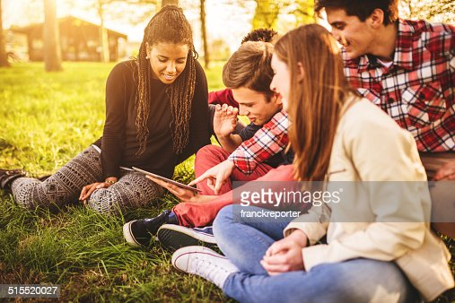 Group of college student laughing and studying togetherness