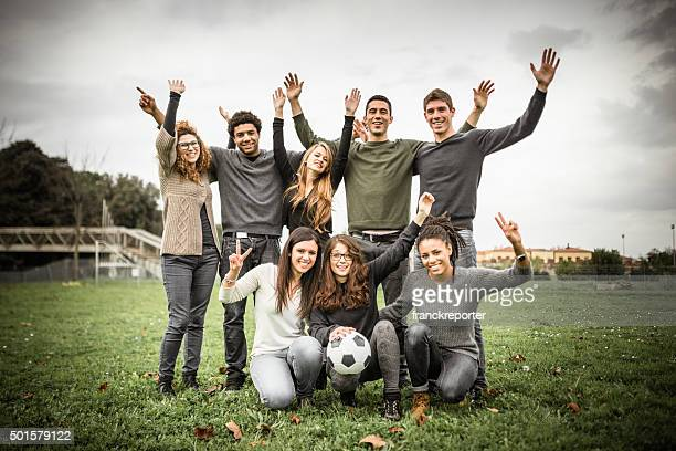 Group of college student posing after the match