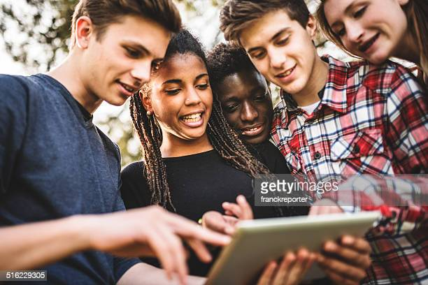 Group of college student using the tablet togetherness