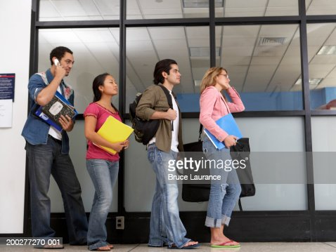 Group Of College Students Standing In Line Stock Photo