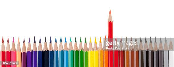 Group of colored pencils with one out from the crowd