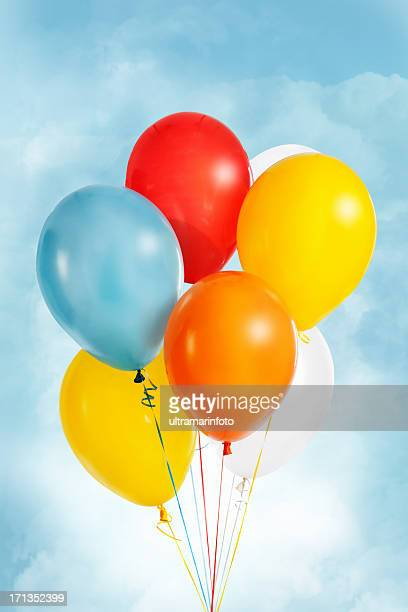 Group of colorful balloons flying in the sky