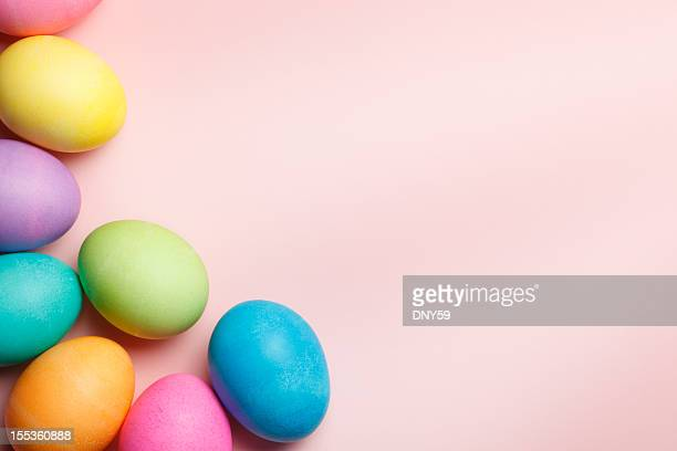 Group of colorful Easter eggs on pink background