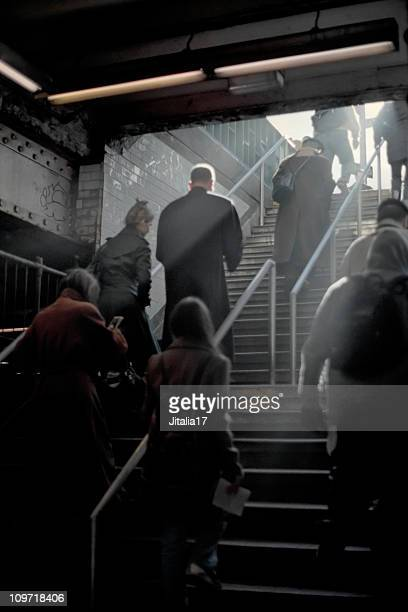 Group of Commuters Climbing Backlit Subway Steps - New York