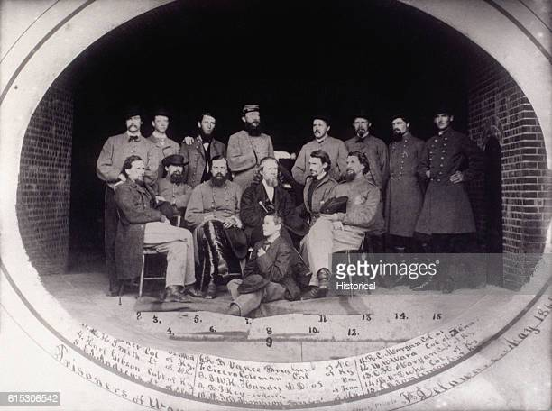 A group of Confederate prisoners of war pose while being held at Fort Delaware near Philadelphia during the American Civil War Seated are Captain...