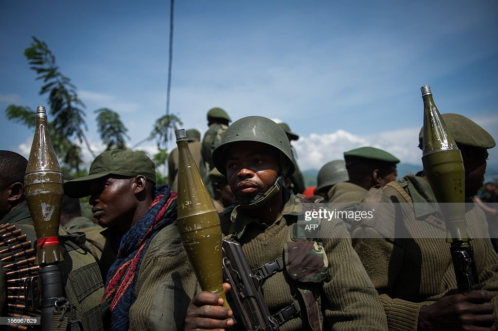 A group of Congolese National Army soldiers drive in the back of a jeep near to a military headquarters in Minova, in the east of the Democratic Republic of the Congo on November 26, 2012. Minova has become a bastion of government troops after they were routed from Goma last week by M23 rebels.