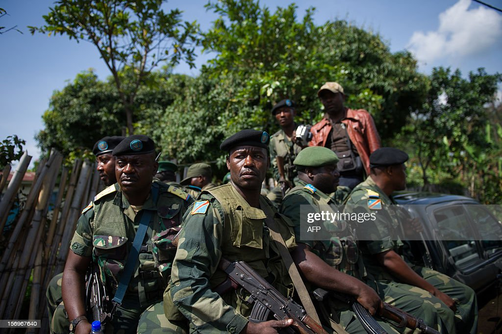 A group of Congolese National Army soldiers drive in the back of a jeep near to a military headquarters in the town of Minova, in the east of the Democratic Republic of the Congo, on November 26, 2012. Minova has become a bastion of government troops after they were routed from Goma last week by M23 rebels.