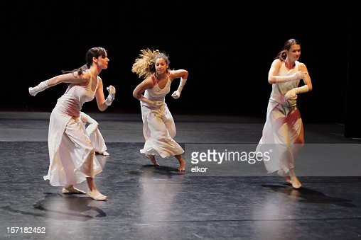 Group of contemporary dancers performing on stage.