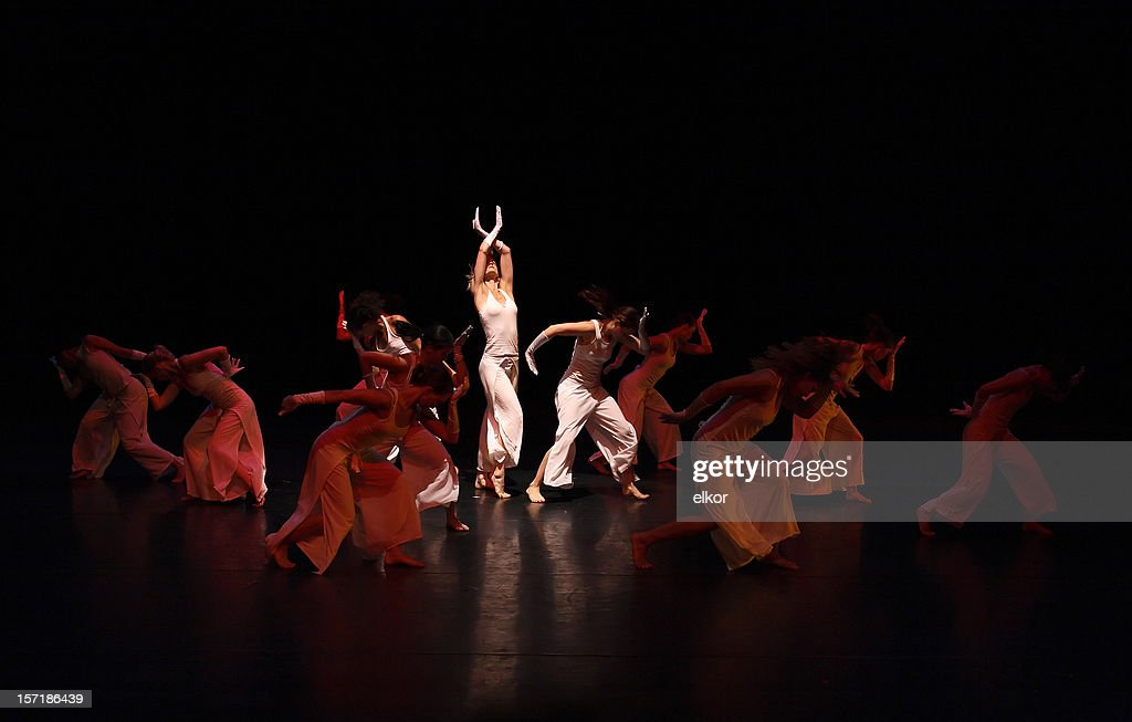 Group of contemporary dancers performing on stage : Stock Photo