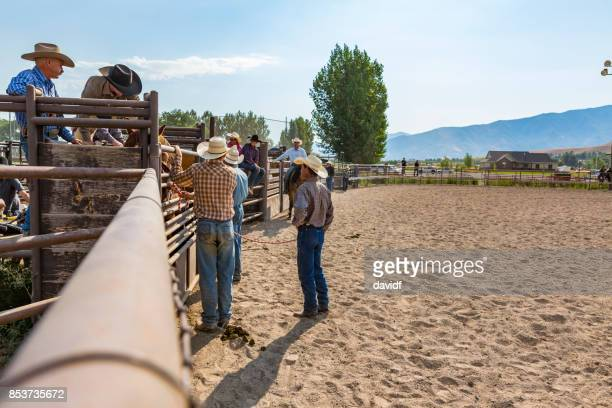 Group of Cowboys Waiting and Watching at a Rodeo