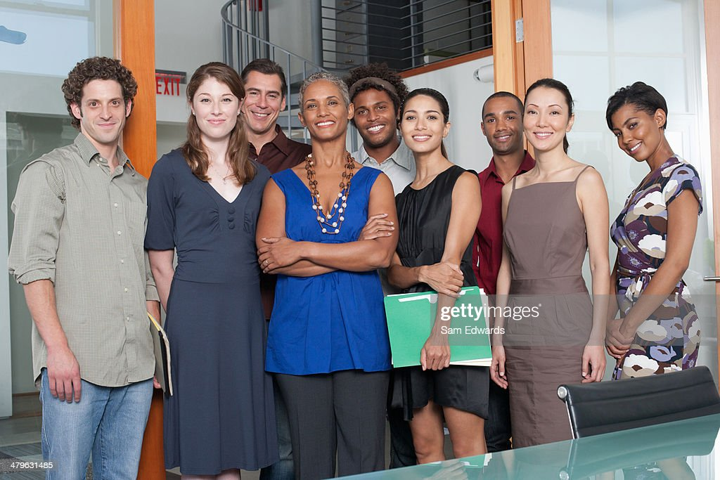 Group of coworkers in an office smiling