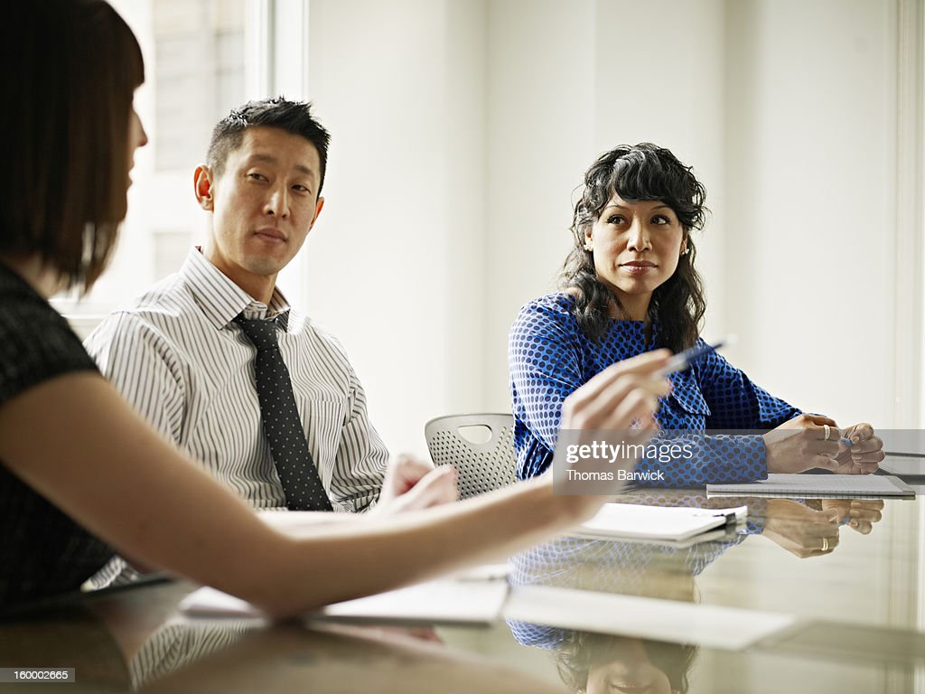 Group of coworkers in discussion in office : Stock Photo