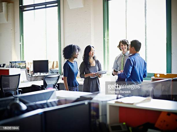 Group of coworkers in discussion in office