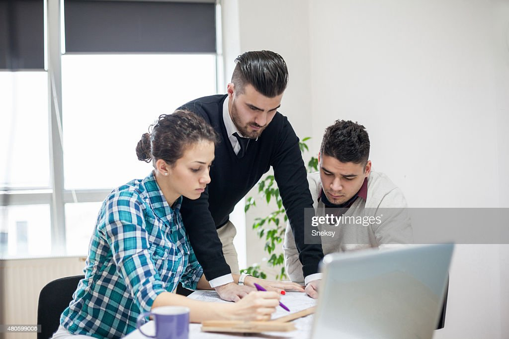 Group of coworkers working together : Stock Photo