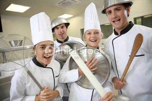Group of crazy cooks with kitchenware stock photo thinkstock for Atelier cours de cuisine