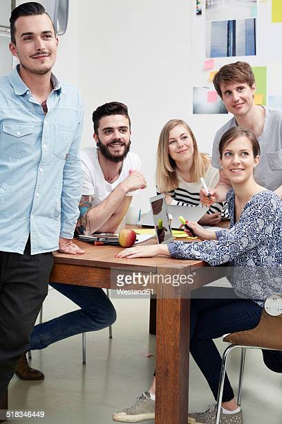 Group of creative professionals at table