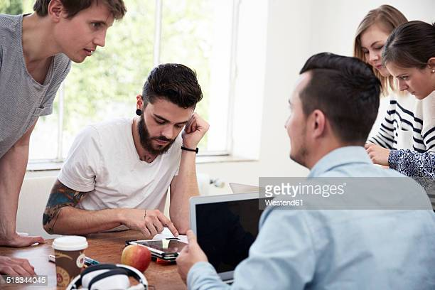 Group of creative professionals having a meeting