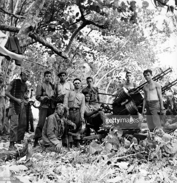 A group of Cuban revolutionary Fidel Castro's soldiers with artillery after routing the USbacked invasion at the Bay of Pigs
