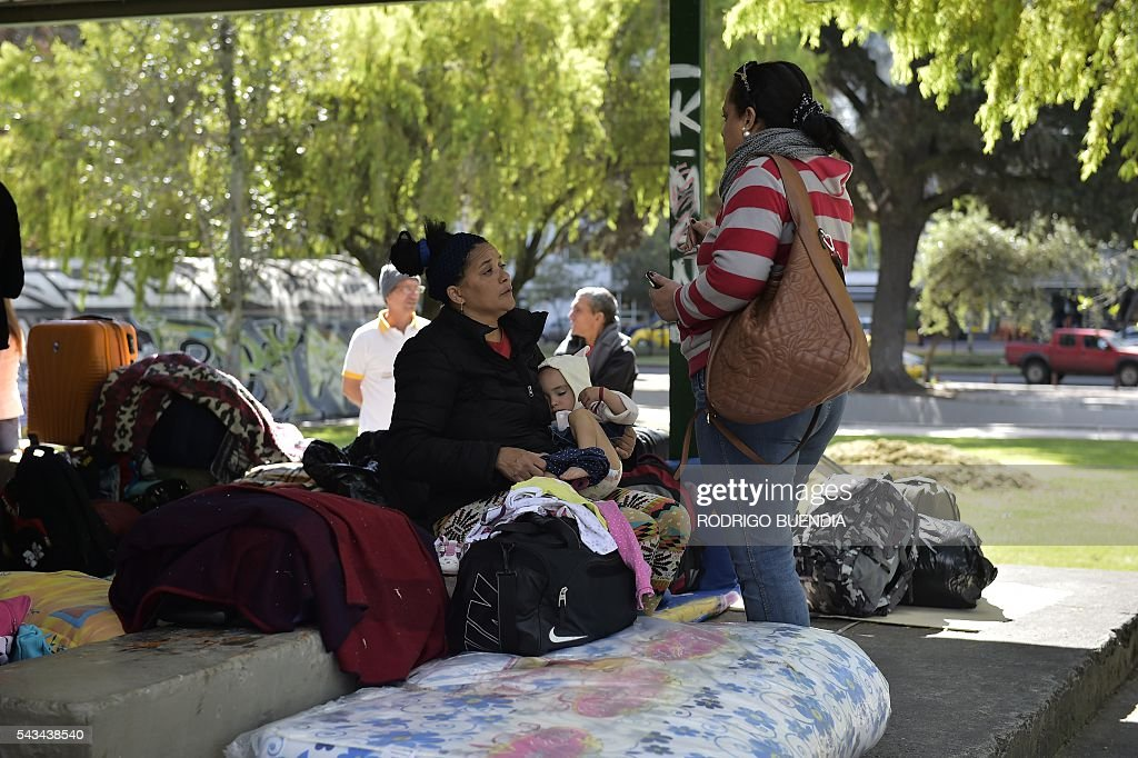 A group of Cubans camp in a park in Quito on June 28, 2016 demanding to Mexico humanitarian visas to travel to the United States. BUENDIA