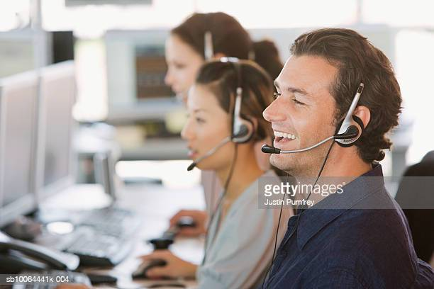 Group of customer service representatives at work, side view
