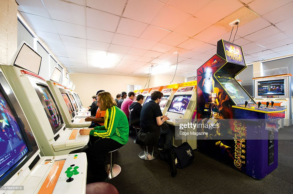 A group of customers playing games inside The Heart Of Gaming video game arcade in London on May 8 2013