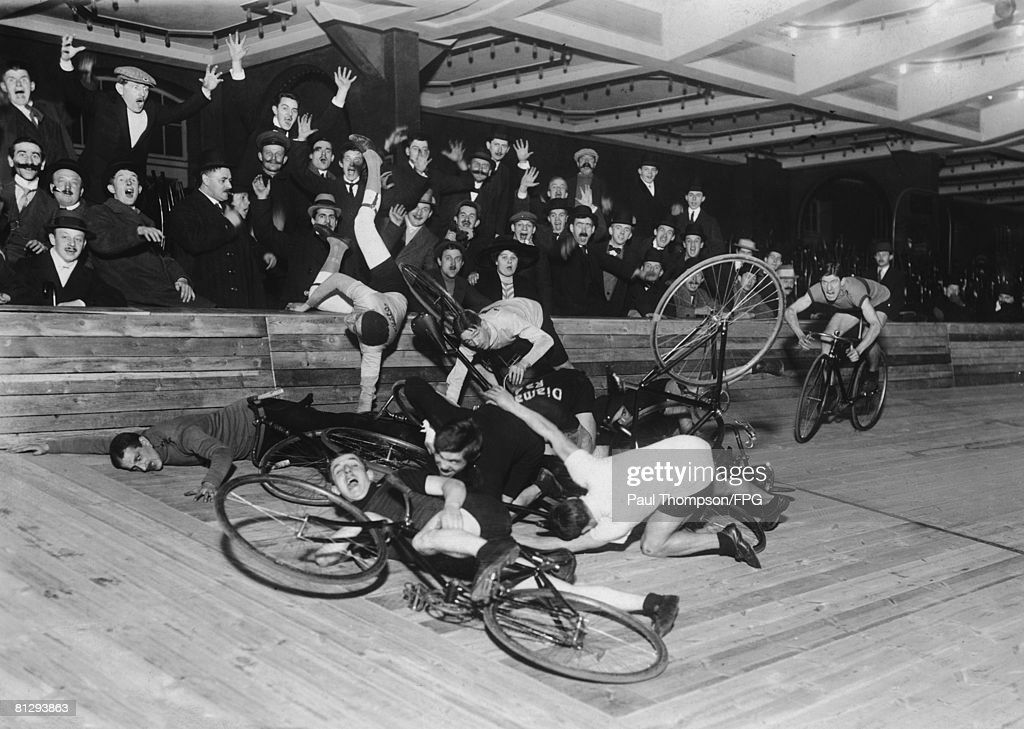A group of cyclists collapse in a heap, to the consternation of the audience, circa 1910.