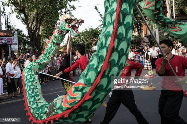 A group of dancers perform a Chinese traditional dragon dance during 'Ngelawang' ritual on January 30 2014 in Kuta Indonesia Ngelawang ritual is a...