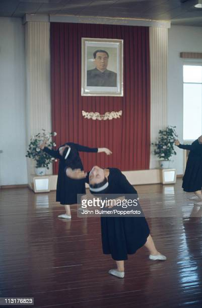 A group of dancers performing in North Korea February 1973 On the wall is a portrait of North Korean Communist leader Kim Ilsung
