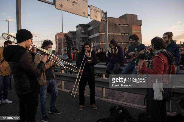 A group of demonstrators play music as they block a highway during a regional strike on November 8 2017 in Barcelona Spain ProIndependence Unions and...