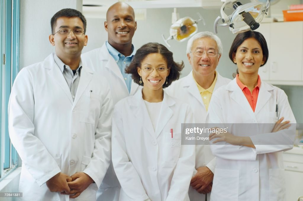 Group of dentists smiling : Stock Photo