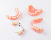 Group of dentures on white background.