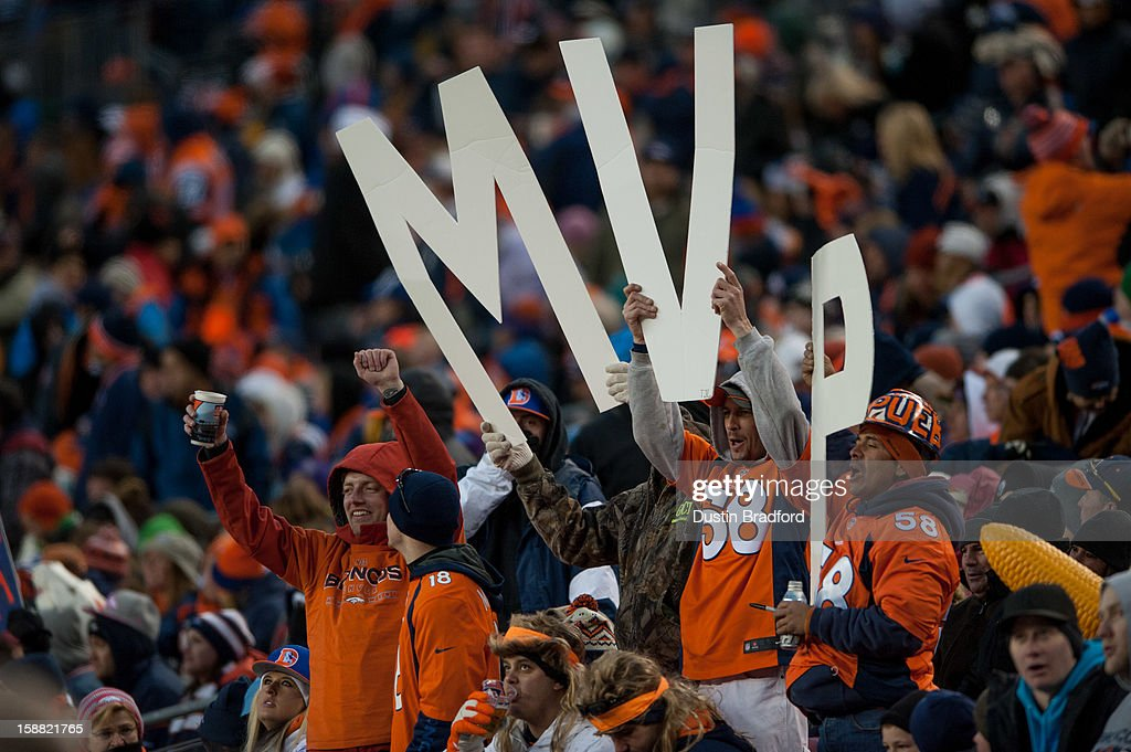 A group of Denver Broncos fans holds up large 'MVP' letters in support of the MVP bid of quarterback Peyton Manning #18 during a game against the Kansas City Chiefs at Sports Authority Field Field at Mile High on December 30, 2012 in Denver, Colorado. The Broncos defeated the Chiefs 38-3.