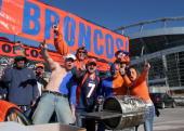 A group of Denver Broncos fans tailgate before the start of Denver's game against the Baltimore Ravens at Invesco Field in Denver Colorado December...