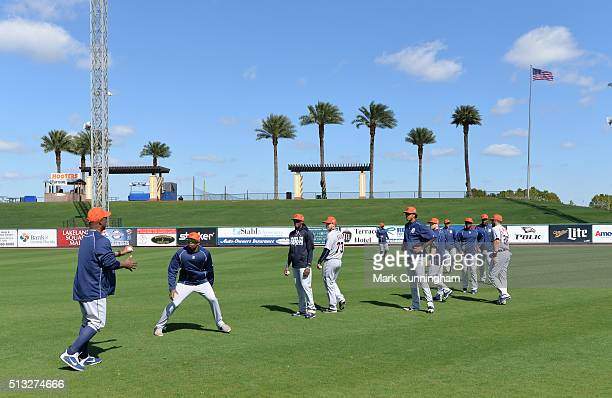 A group of Detroit Tigers outfielders work on a fielding drill during the Spring Training workout day at Joker Marchant Stadium on February 25 2016...