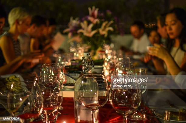 A group of diners enjoy an al fresco meal at a private kitchen's dinner party in Hong Kong
