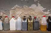 plastic containers, oil can, grunge bottles and tanks