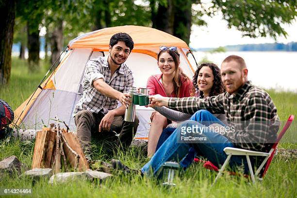 Group of diverse adults toasting to their weekend camping advenure