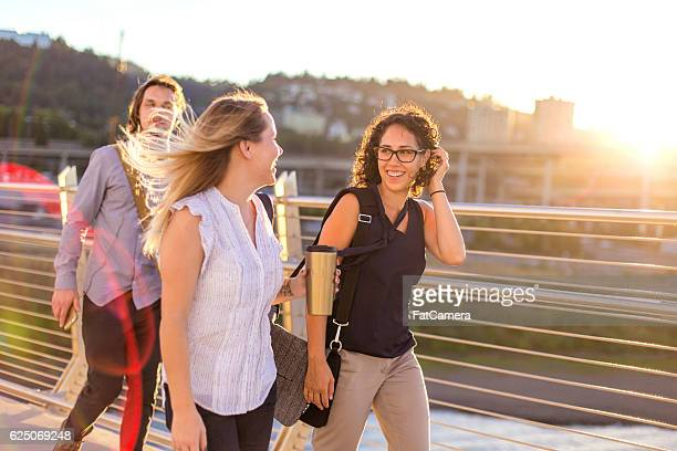 Group of diverse female professionals chatting while walking to work