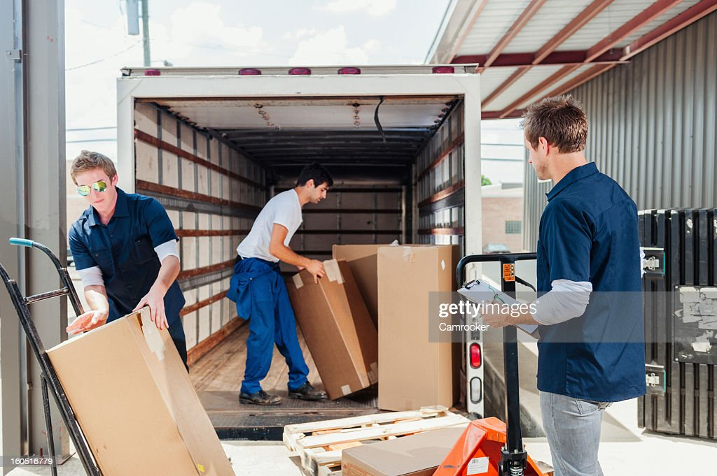 Dock Workers Loading A Delivery Truck : Stock Photo