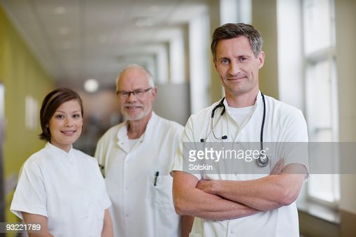group of doctors and a nurse in hospital : Stock Photo