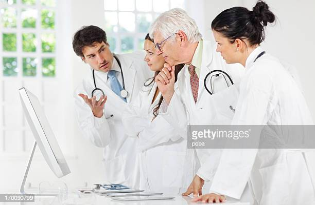 group of doctors discussing and using a digital tablet ,computor