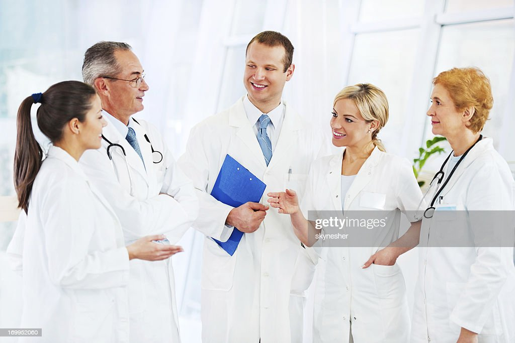 Group of doctors discussing medical case. : Stock Photo