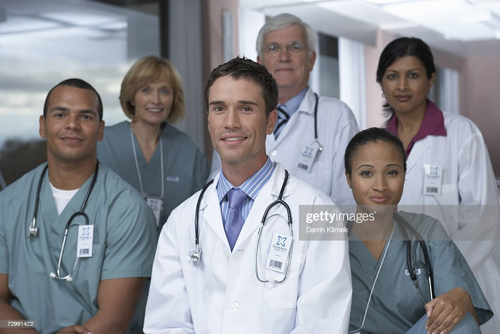 'Group of doctors smiling, portrait' : Stock Photo