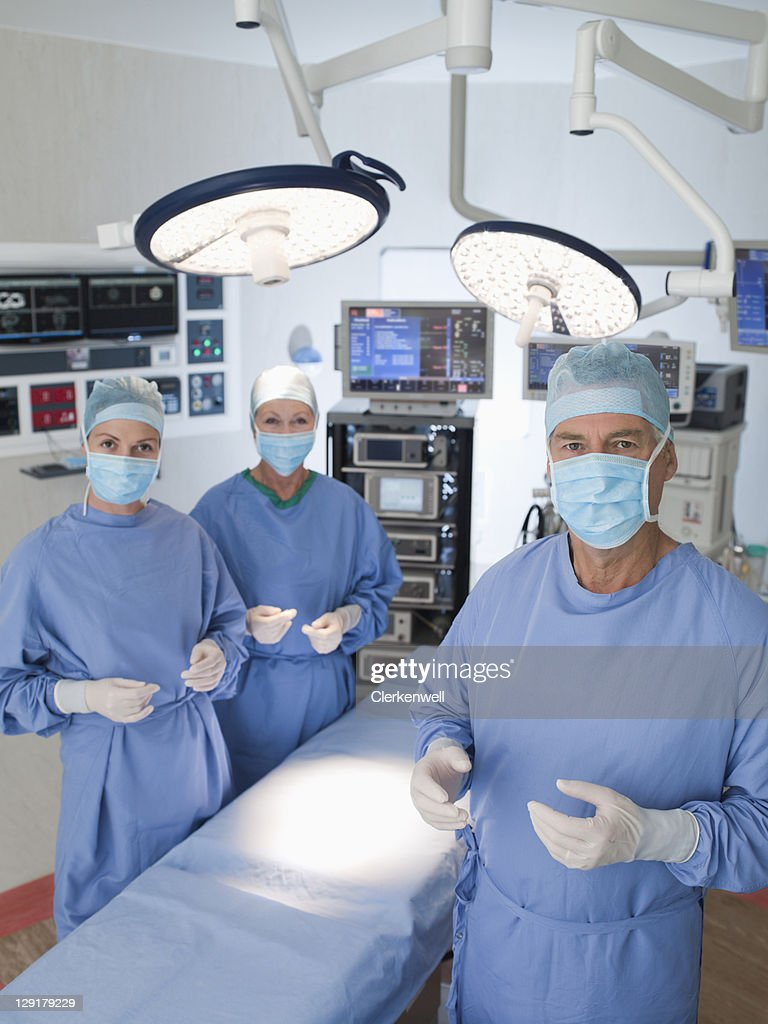 Group of doctors standing in operating room : Stock Photo