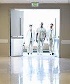Group of doctors walking in hospital, motion blur